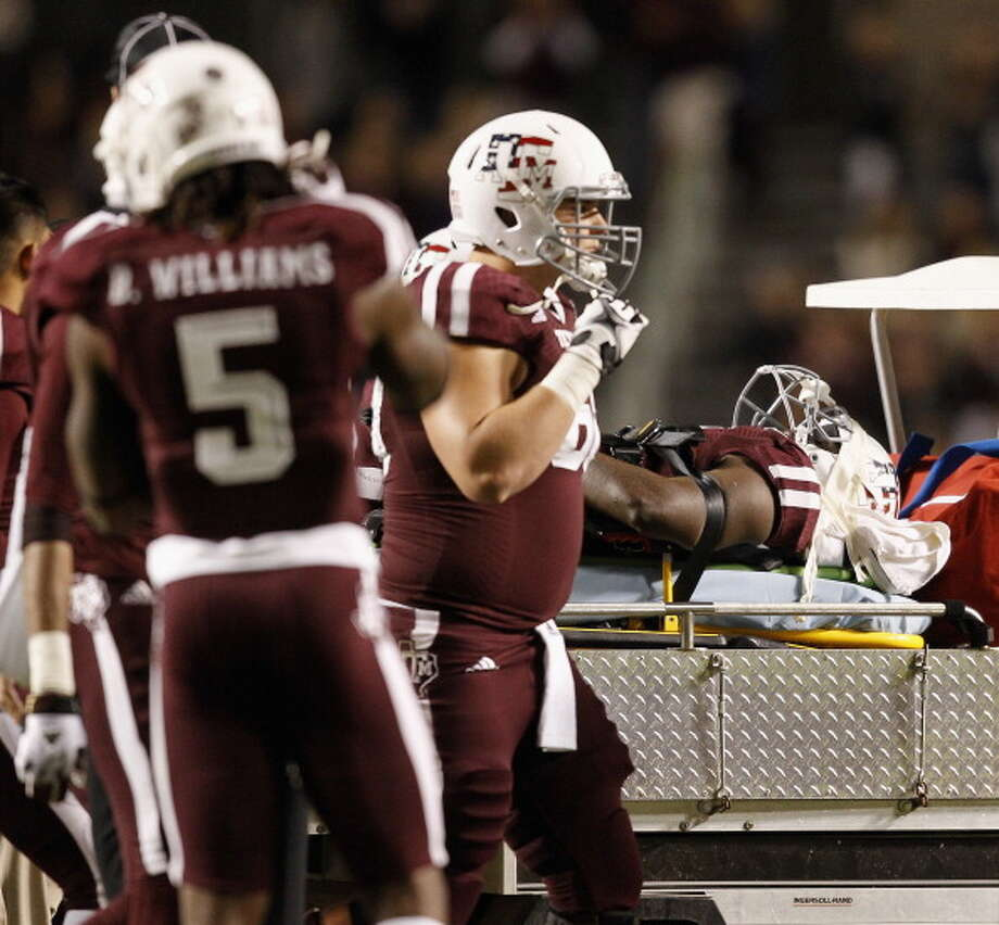 Tra Carson #21 of the Texas A&M Aggies is carted off the field in the fourth quarter after sustaining a neck injury against the UTEP Miners at Kyle Field on November 2, 2013 in College Station, Texas. Photo: Bob Levey, Getty Images / 2013 Getty Images