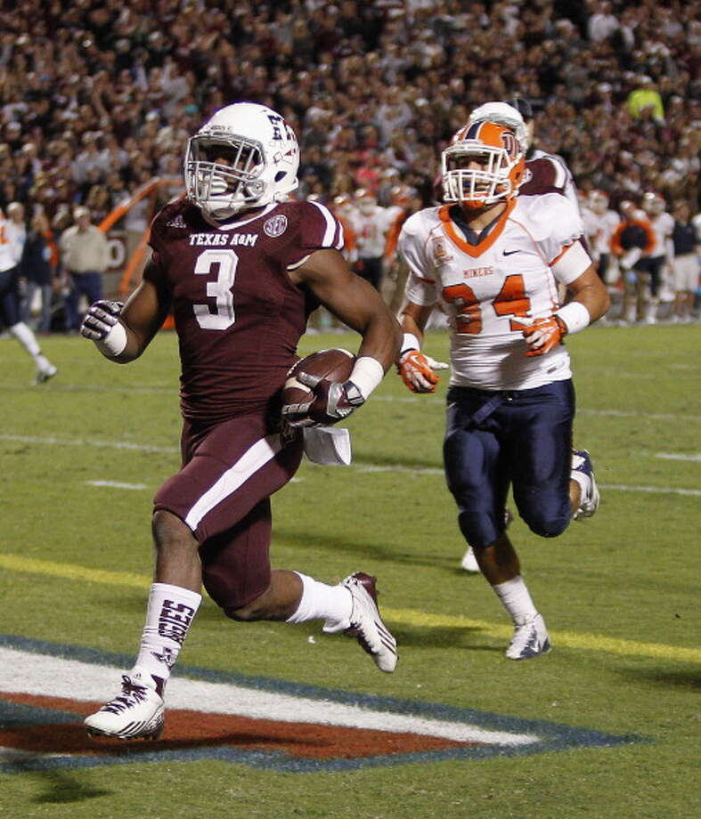 Trey Williams #3 of the Texas A&M Aggies beats Anthony Puente #34 of the UTEP Miners to the endzone for a  14 yard score at Kyle Field on November 2, 2013 in College Station, Texas. Photo: Bob Levey, Getty Images / 2013 Getty Images