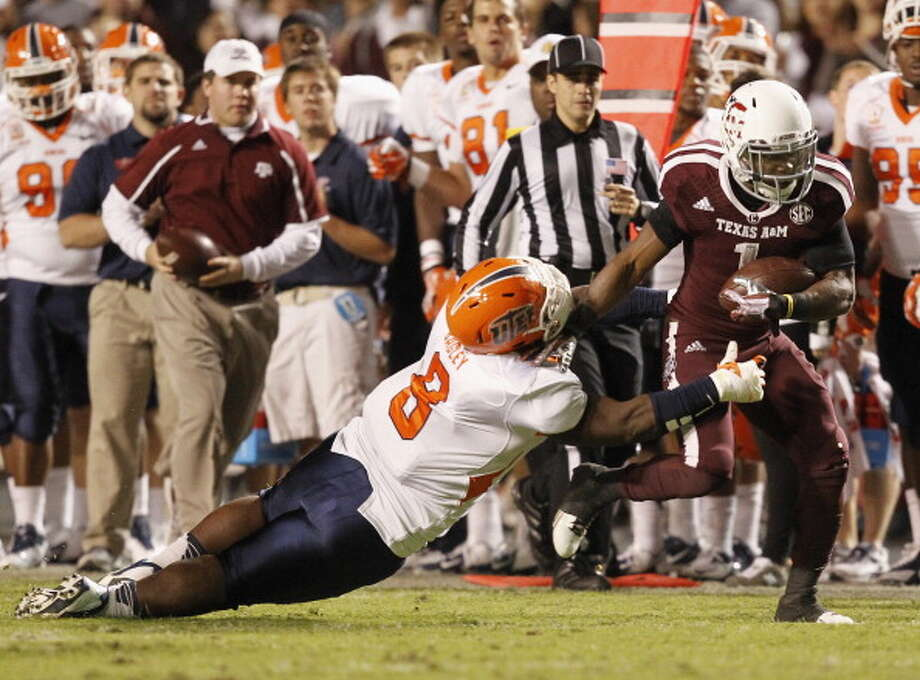 Ben Malena #1 of the Texas A&M Aggies breaks the tackle attempt of  Marcus Bagley #8 of the UTEP Miners at Kyle Field on November 2, 2013 in College Station, Texas. Photo: Bob Levey, Getty Images / 2013 Getty Images