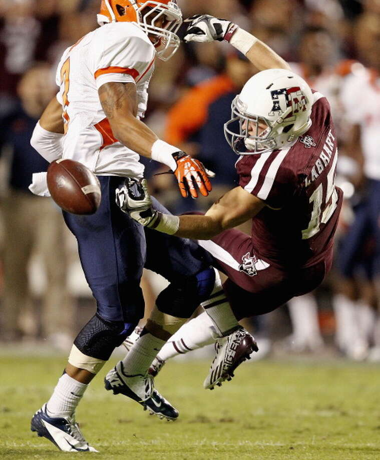 Travis Labhart #15 of the Texas A&M Aggies can't hold on to the ball as he is defended by Traun Roberson #3 of the UTEP Miners at Kyle Field on November 2, 2013 in College Station, Texas. Traun Roberson was called for pass interference on the play. Photo: Bob Levey, Getty Images / 2013 Getty Images