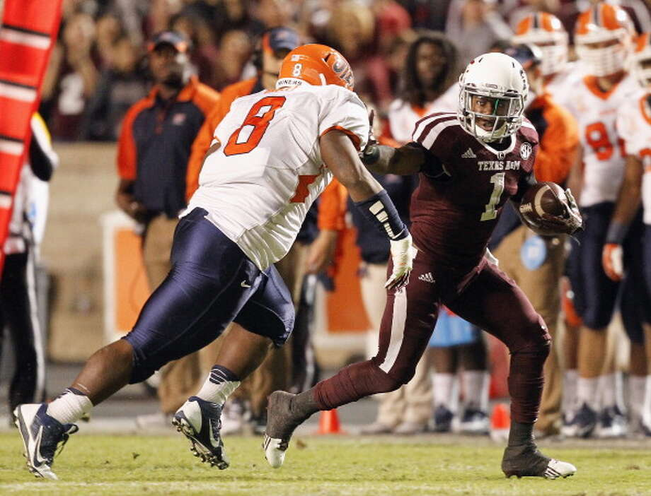Ben Malena #1 of the Texas A&M Aggies stiff arms the tackle attempt of  Marcus Bagley #8 of the UTEP Miners at Kyle Field on November 2, 2013 in College Station, Texas. Photo: Bob Levey, Getty Images / 2013 Getty Images
