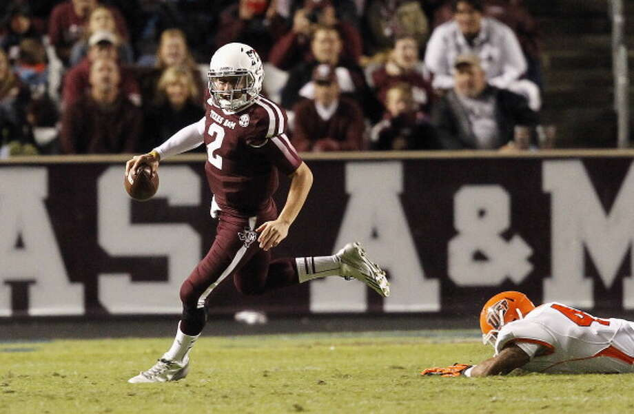 Johnny Manziel #2 of the Texas A&M Aggies scrambles out of the pocket against the UTEP Miners at Kyle Field on November 2, 2013 in College Station, Texas. Photo: Bob Levey, Getty Images / 2013 Getty Images
