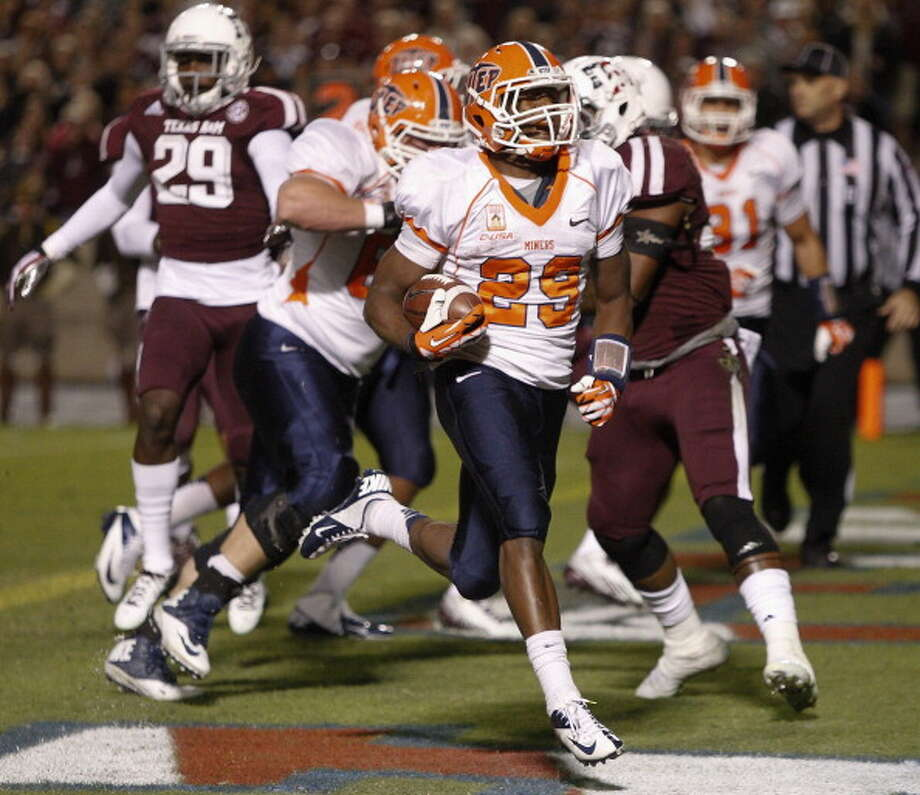 Aaron Jones #29 of the UTEP Miners rushes for a touchdown in the first quarter against the Texas A&M Aggies at Kyle Field on November 2, 2013 in College Station, Texas. Photo: Bob Levey, Getty Images / 2013 Getty Images