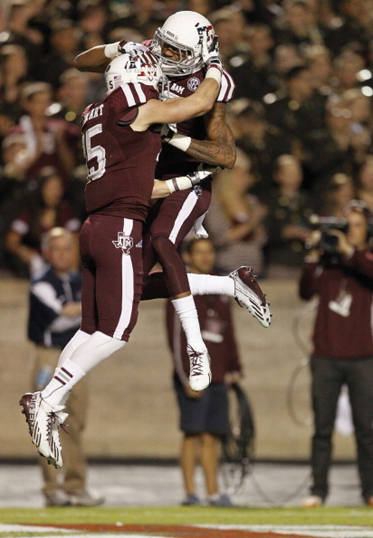 Travis Labhart #15 of the Texas A&M Aggies celebrates with Mike Evans #13 after scoring in the first quarter against the UTEP Miners at Kyle Field on November 2, 2013 in College Station, Texas.