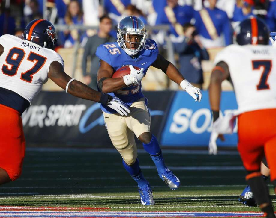 Tulsa's Ja'Terian Douglas looks for running room against UTSA during the second half of an NCAA college football game at Chapman Stadium, Saturday, Nov. 2, 2013, in Tulsa, Okla. UTSA won 34-15. Photo: Tom Gilbert, Tulsa World