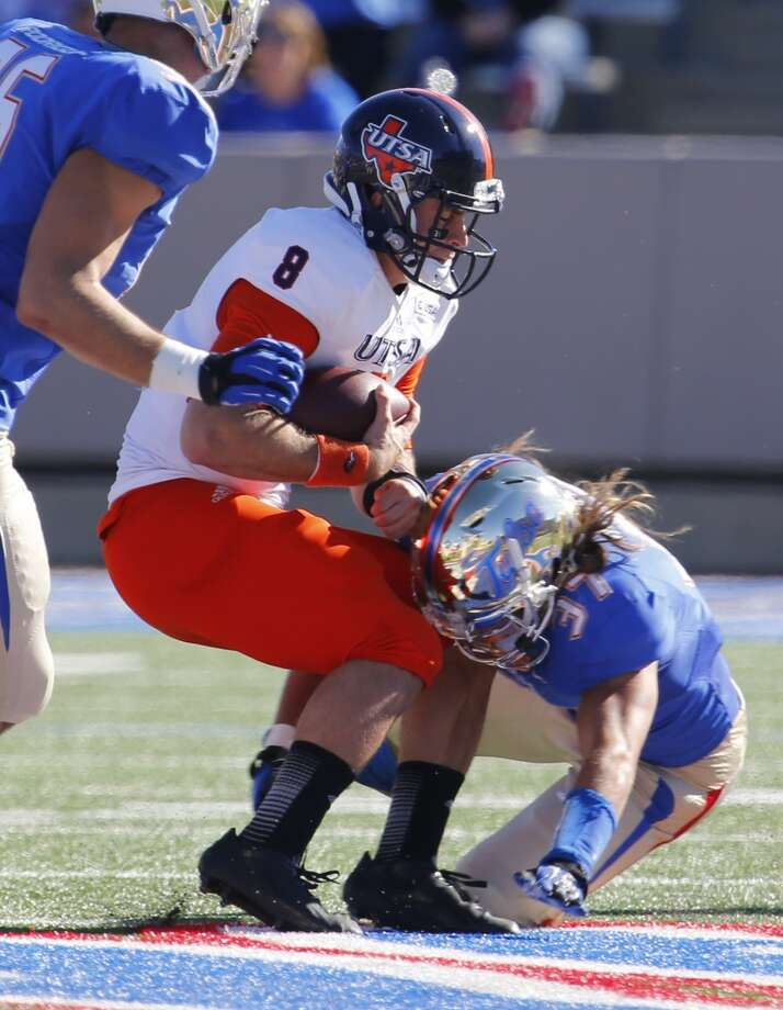 UTSA's Eric Soza (8) is tackled by Tulsa's Austin McDaniel during the first half of an NCAA college football game at Chapman Stadium, Saturday, Nov. 2, 2013, in Tulsa, Okla. Photo: Tom Gilbert, Tulsa World