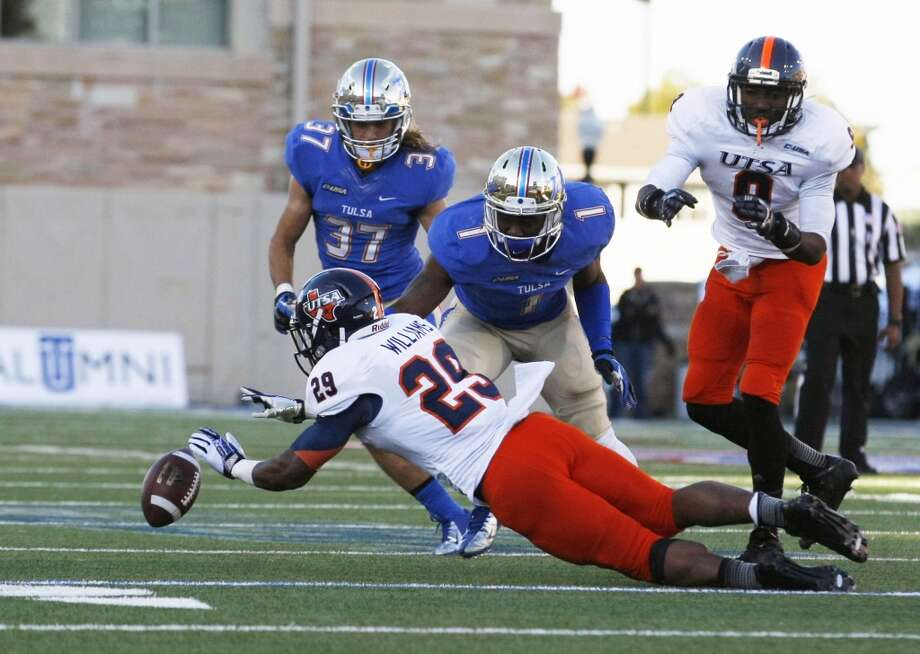 UTSA's Jarveon Williams (29) fumbles as Tulsa's Michael Mudoh (1) and Austin McDaniel (37) recover during the second half of an NCAA college football game at Chapman Stadium, Saturday, Nov. 2, 2013, in Tulsa, Okla. UTSA won 34-15. Photo: Tom Gilbert, Tulsa World