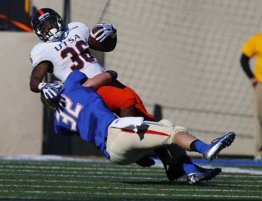 UTSA's Evans Okotcha (36) is tackled by Tulsa's Mitchell Osborne (32) during the first half of an NCAA college football game at Chapman Stadium, Saturday, Nov. 2, 2013, in Tulsa, Okla. UTSA won 34-15. Photo: Tom Gilbert, Tulsa World