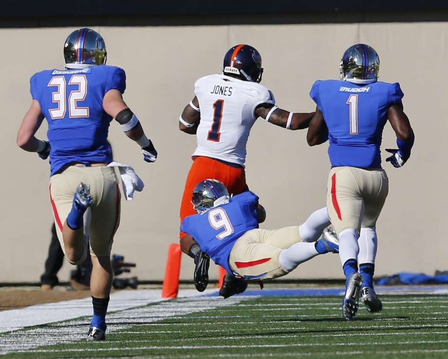 Tulsa's Dwight Dobbins (9) tries to take down UTSA's Kam Jones (1) as he heads toward the end zone during the first half of an NCAA college football game at Chapman Stadium, Saturday, Nov. 2, 2013, in Tulsa, Okla. UTSA won 34-15. Photo: Tom Gilbert, Tulsa World