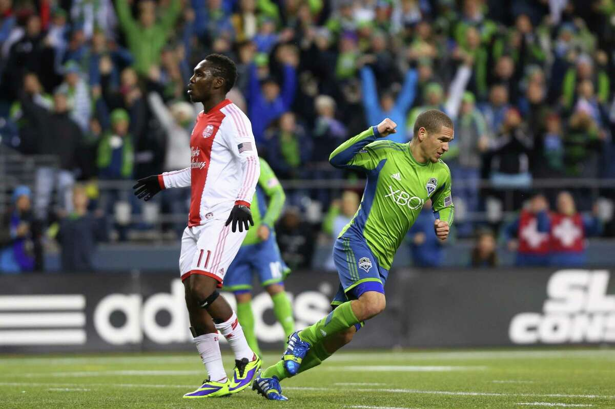 Seattle Sounders player Osvaldo Alonso reacts to a goal late in the game against the Portland Timbers during an MLS playoff match between the two Pacific Northwest rivals. The Sounders fell to the Timbers 2-1.