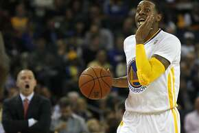 Warriors' Andre Iguodala calls a play as he takes the ball down the court in the first half of the Warriors vs. Kings game November 2, 2013 at the Oracle Arena in Oakland, Calif.