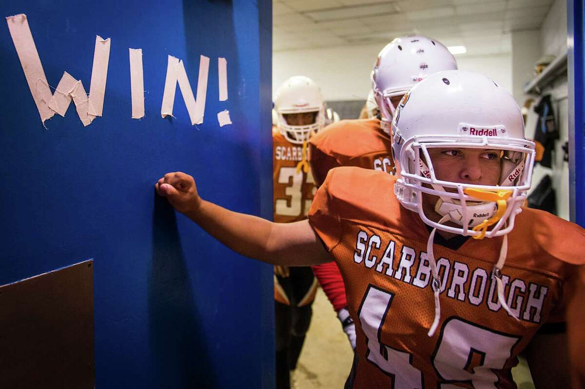 Scarborough players leave the locker room before facing Furr at Dyer Stadium. The team hasn't won a game since 2009, putting the Spartans in the midst of the longest active losing streak in the state. ( Smiley N. Pool / Houston Chronicle )