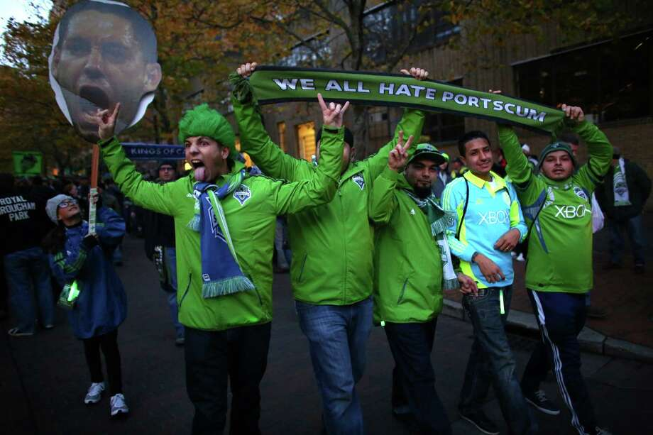 Seattle Sounders fans participate in the March to the Match before a an MLS playoff match against the Portland Timbers. The Sounders fell to the Timbers 2-1. Photographed on Saturday, November 2, 2013. Photo: JOSHUA TRUJILLO, SEATTLEPI.COM / SEATTLEPI.COM