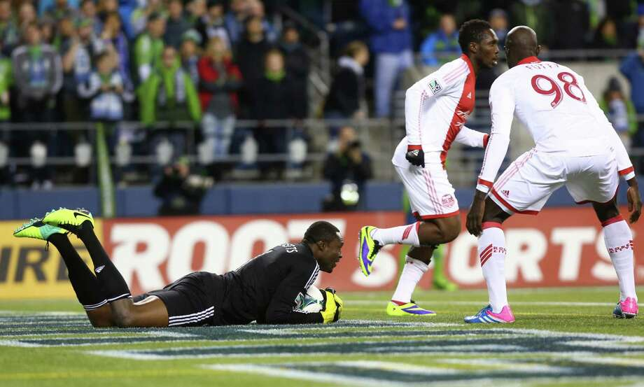 Portland Timbers goal keeper Donovan Ricketts makes a save against the Seattle Sounders during an MLS playoff match between the two Pacific Northwest rivals. The Sounders fell to the Timbers 2-1. Photographed on Saturday, November 2, 2013. Photo: JOSHUA TRUJILLO, SEATTLEPI.COM / SEATTLEPI.COM