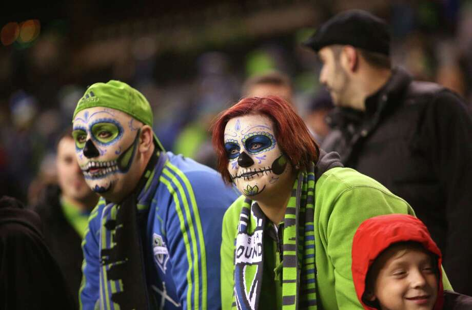 Seattle Sounders fans wear Day of the Dead makeup during a match against the Portland Timbers. The Sounders fell to the Timbers 2-1. Photographed on Saturday, November 2, 2013. Photo: JOSHUA TRUJILLO, SEATTLEPI.COM / SEATTLEPI.COM