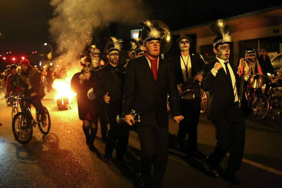 Led by the band Tubaluba, participants march through the Georgetown neighborhood alongside a flaming coffin during a Day of the Dead funeral march and party. Photo: JOSHUA TRUJILLO, SEATTLEPI.COM / SEATTLEPI.COM