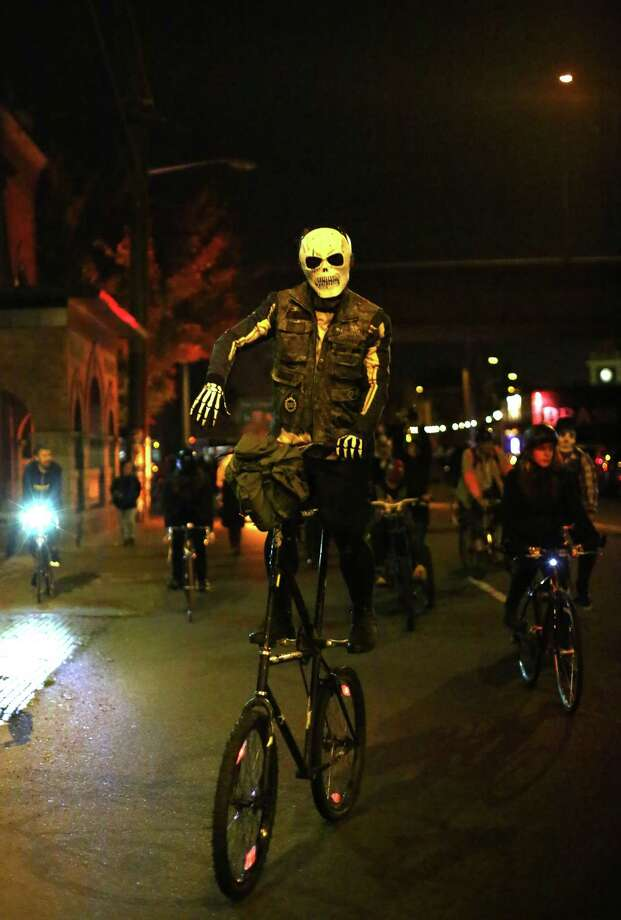 Led by the band Tubaluba, participants march, and ride, through the Georgetown neighborhood alongside a flaming coffin during a Day of the Dead funeral march and party. Photo: JOSHUA TRUJILLO, SEATTLEPI.COM / SEATTLEPI.COM