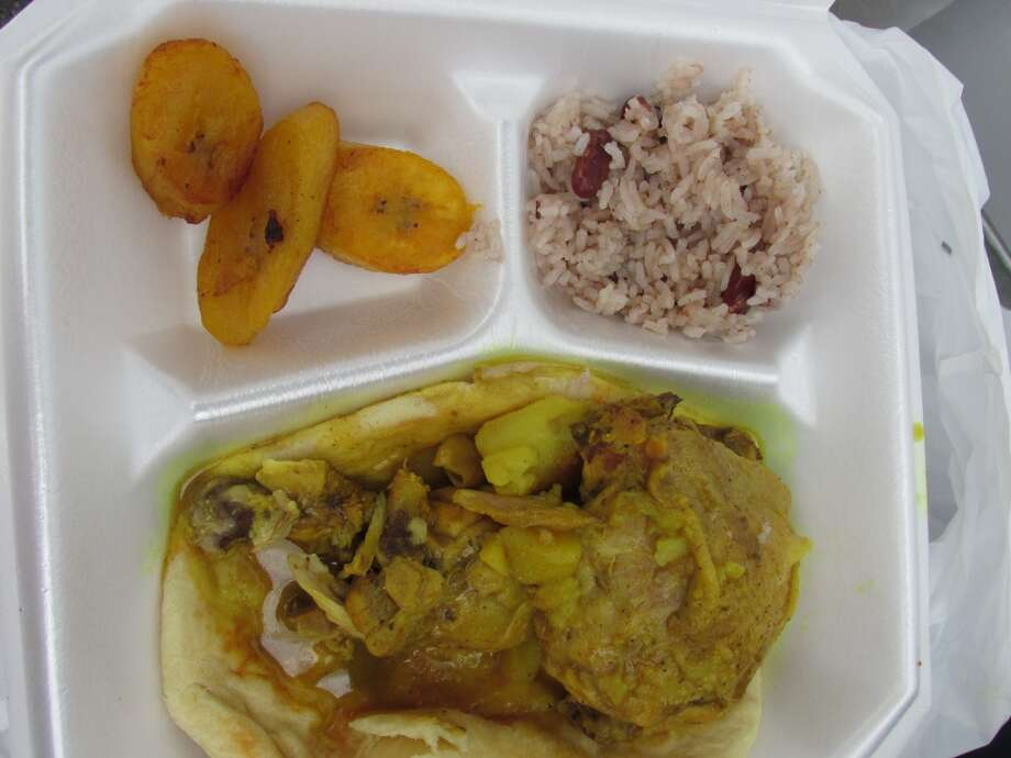 The Jamaican Cajun food truck's curry chicken roti wrap, served with plantains, peas and rice. Photo: Cat5