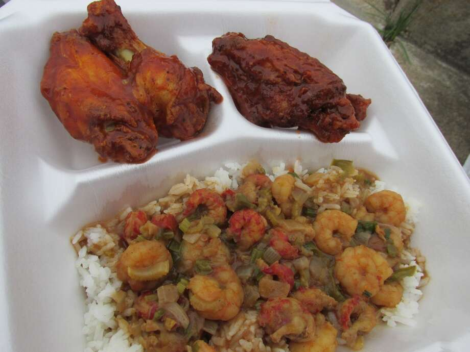 JaCajun chicken wings with crawfish and shrimp etoufee, served over jasmine rice at the Jamaican Cajun food truck. Photo: Cat5