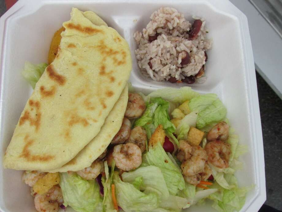 The Jamaican Cajun food truck's JaCajun shrimp salad, served with roti bread and peas and rice. Photo: Cat5
