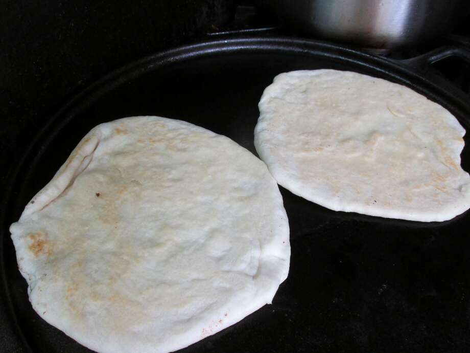 Roti bread on the grill at the Jamaican Cajun food truck. Photo: Cat5