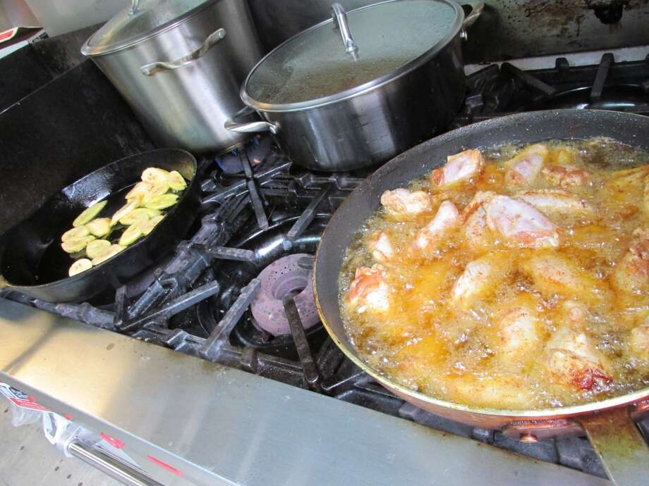 Plantains and chicken on the grill at the Jamaican Cajun food truck. Photo: Cat5