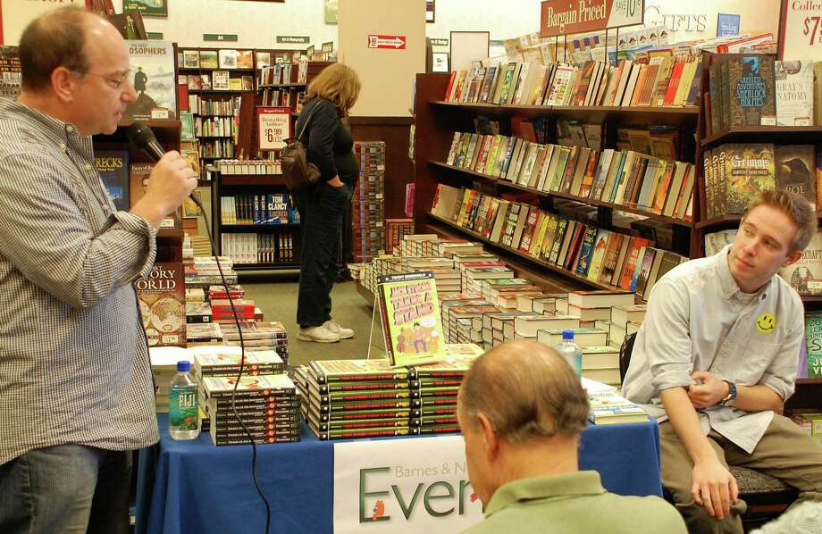 "Local writer Tommy Greenwald, left, and son Charlie shared light-hearted back-and-forth as part of Greenwald's promotion for his new book ""Jack Strong Takes a Stand"" at the Barnes & Noble store Saturday. Photo: Jarret Liotta / Westport News contributed"