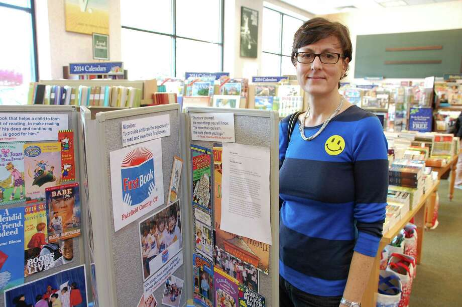 "Melanie Myers of Southport wears a ""smiley face"" sticker on Saturday to show support for the Barnes & Noble book fair benefiting First Book Fairfield County. Photo: Jarret Liotta / Westport News contributed"