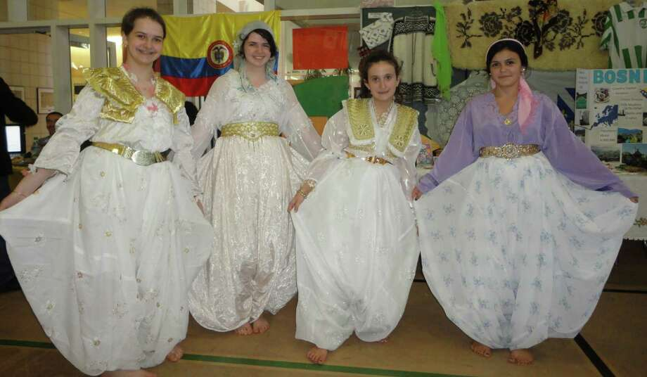 Dressed in authentic Bosnian costumes at the McKinley School World's Fair on Saturday, from left, are Emma Kojic, 12; her sister Semina Kojic, 17; Irma Cirikovic, 12, and her sister Fikreta Cirikovic, 15. Photo: Meg Barone / Fairfield Citizen contributed