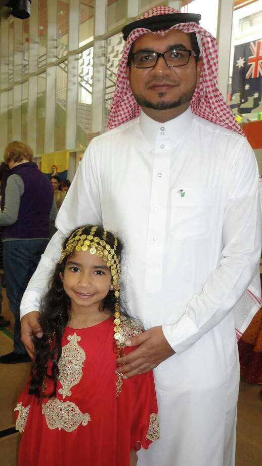 Sameer Kahn of Fairfield and his daughter Lamar Khan, 6, dressed in authentic Saudi Arabian attire for the McKinley School World's Fair. Photo: Meg Barone / Fairfield Citizen contributed