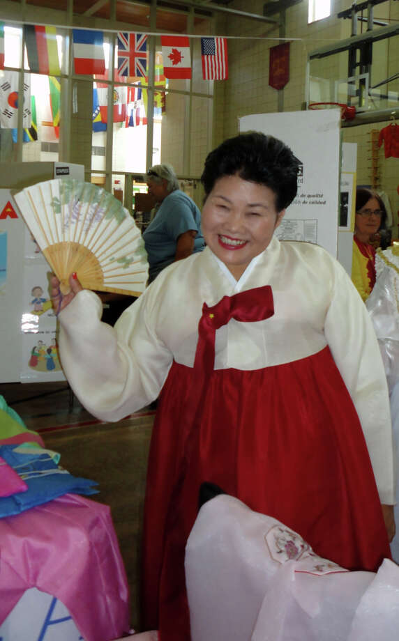 Sharon Lee wore a tradtional Korean chima -- a skirt, and a jeogori -- a jacket at the McKinley School World's Fair. Photo: Meg Barone / Fairfield Citizen contributed