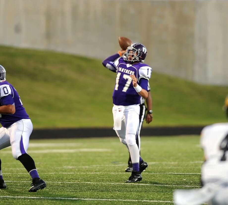 Ridge Point quarterback Jesse Crebbe (17) throws a pass in the second quarter during Ridge Point's 70-7 win over Spring Woods on Nov. 2 at Hall Stadium. Photo: Eddy Matchette, For The Chronicle / Freelance