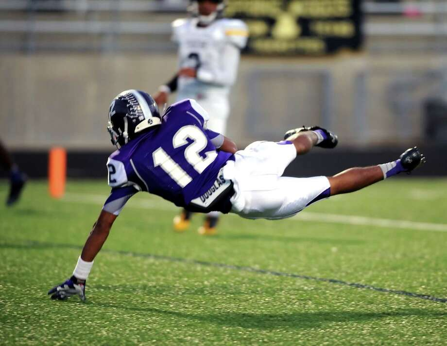 Ridge Point Terry Petry (12) dives in the end zone and catches a pass to score during Ridge Point's 70-7 win over Spring Woods on Nov. 2 at Hall Stadium. Photo: Eddy Matchette, For The Chronicle / Freelance