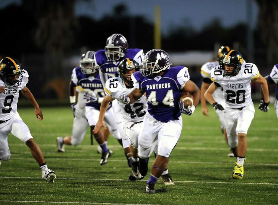 Ridge Point fullback Josh Burrell (44) breaks away from the pack to gain sizeable yardage  during Ridge Point's 70-7 win over Spring Woods on Nov. 2 at Hall Stadium. Photo: Eddy Matchette, For The Chronicle / Freelance