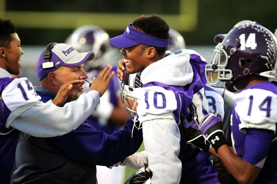 Ridge Point coach Brett Sniffin is in the middle of a celebration after a Ridge Point score during Ridge Point's 70-7 win over Spring Woods on Nov. 2 at Hall Stadium. Photo: Eddy Matchette, For The Chronicle / Freelance