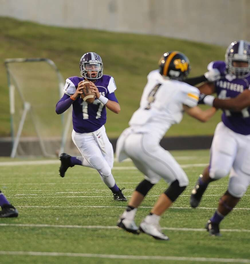 Ridge Point quarterback Jesse Crebbe (17) rolls out to pass against Spring Woods  during Ridge Point's 70-7 win over Spring Woods on Nov. 2 at Hall Stadium. Photo: Eddy Matchette, For The Chronicle / Freelance