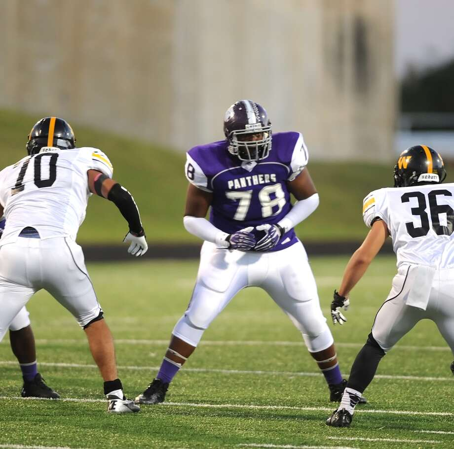 Ridge Point offensive lineman Arien Ferguson (78) controls the line of scrimmage against Spring Woods  during Ridge Point's 70-7 win over Spring Woods on Nov. 2 at Hall Stadium.. Photo: Eddy Matchette, For The Chronicle / Freelance