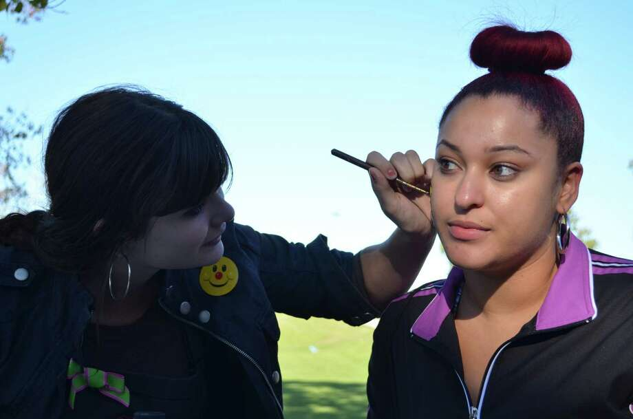 Adrienne Meyers, just one of the many of people came out to show their support at the Hearing Loss Association of America's eighth annual Walk 4 Hearing event, paints a bumble bee on Kimberly Stuckey's face on Saturday, November 2, 2013 in Tom Bass Park. Photo: Derek Salyer, For The Chronicle / Freelance