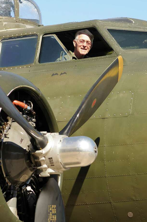 B-17 co-pilot Ole Nygren, of The Woodlands, prepares for a B-17 flight during the B-17 bomber tour and flight at the Tomball Jet Center at Hooks Airport in Spring. Visitors could tour and fly on the B-17 owned and operated by the Commemorative Air Force Gulf Coast Wing based in Houston. Photo by David Hopper Photo: David Hopper, For The Chronicle / freelance