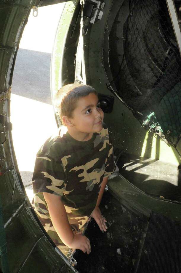 An excited eight year old Quinn Allen, of Spring 77379, climbs aboard the B-17 during the B-17 bomber tour and flight at the Tomball Jet Center at Hooks Airport in Spring. Visitors could tour and fly on the B-17 owned and operated by the Commemorative Air Force Gulf Coast Wing based in Houston. Photo by David Hopper Photo: David Hopper, For The Chronicle / freelance