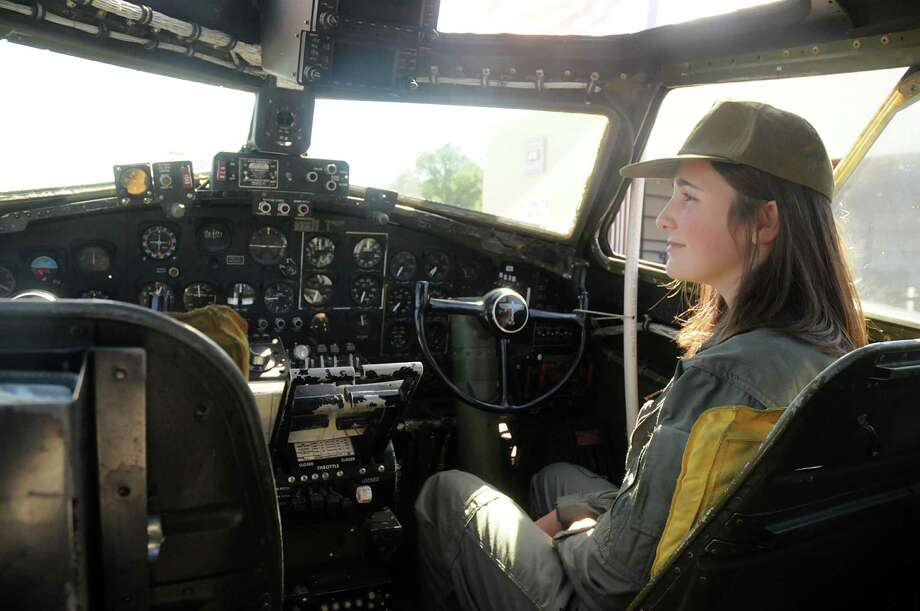 Commemorative Air Force Cadet Carolyn Bienvenu, of The Woodlands, sits in the cockpit, giving tour guests B-17 information during the B-17 bomber tour and flight at the Tomball Jet Center at Hooks Airport in Spring. Visitors could tour and fly on the B-17 owned and operated by the Commemorative Air Force Gulf Coast Wing based in Houston. Photo by David Hopper Photo: David Hopper, For The Chronicle / freelance