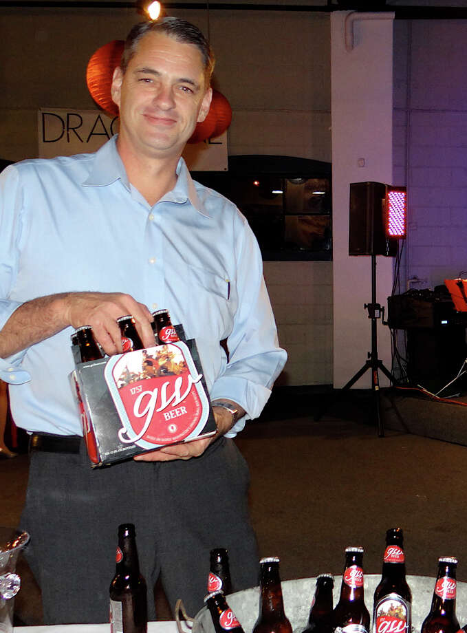 Todd Myers, general manager of GW Beer, represented one of the beer companies offering samples at FSW's Brewfest fundraiser Saturday. Photo: Mike Lauterborn / Westport News contributed