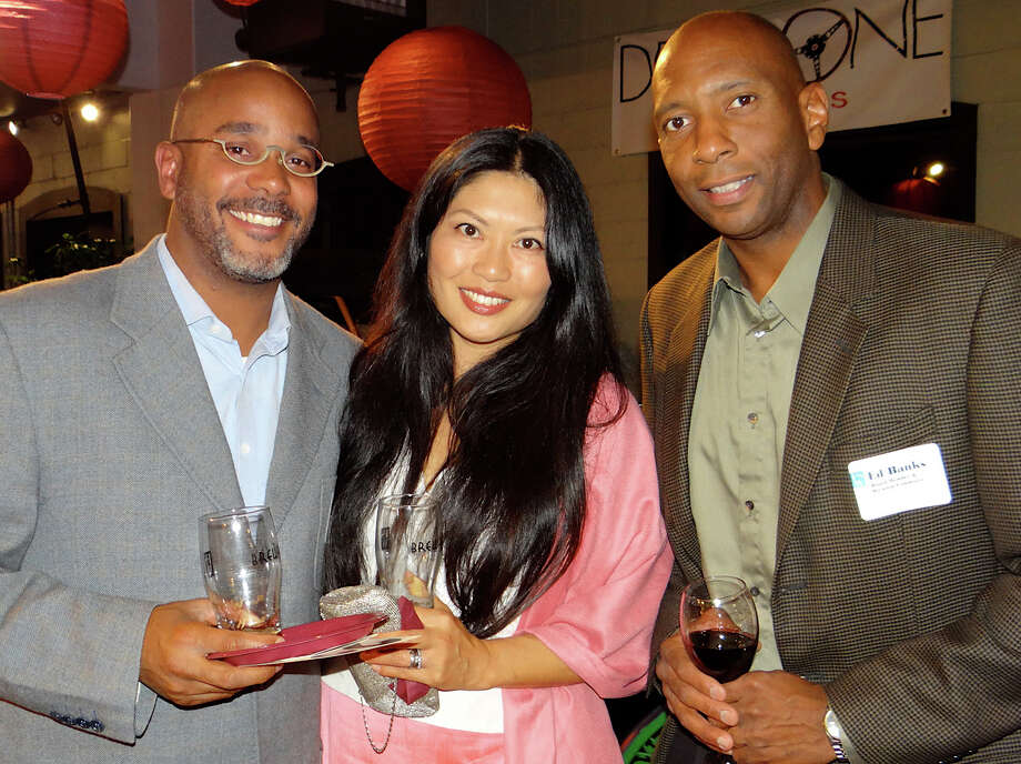 Lorenzo and Tamami Wyatt of Westport, with Ed Banks, an FSW board member, at the agency's Brewfest fundraiser at Dragone Classic Motor Cars. Photo: Mike Lauterborn / Westport News contributed