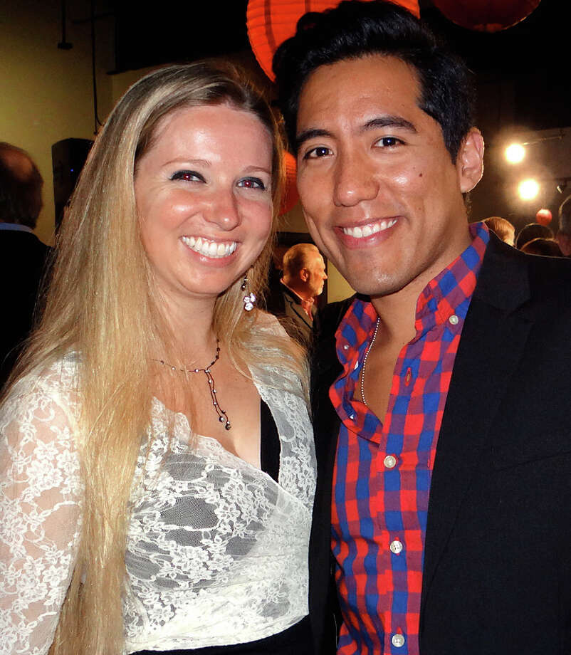 Erin Strong and Renzo Kian-Kubota, the beer and spirits manager at Harry's Wine & Liquor Market in Fairfield, at FSW's Brewfest fundraiser on Saturday night. Photo: Mike Lauterborn / Westport News contributed