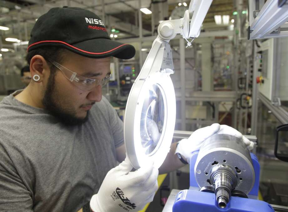 Toshiba employee Jonathan Serna makes a visual inspection on a hybrid car rotor at Toshiba, 13131 West Little York Road, Wednesday, Oct. 9, 2013, in Houston. Photo: Melissa Phillip, Houston Chronicle