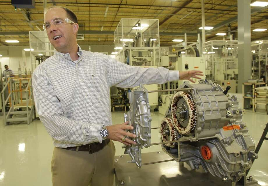 Matthew Bates, Toshiba HEV plant manager, uses a display of a Ford hybrid car transmission to show where the motors and generators assembled at Toshiba, 13131 West Little York Road, are later installed by Ford shown Wednesday, Oct. 9, 2013, in Houston. Photo: Melissa Phillip, Houston Chronicle