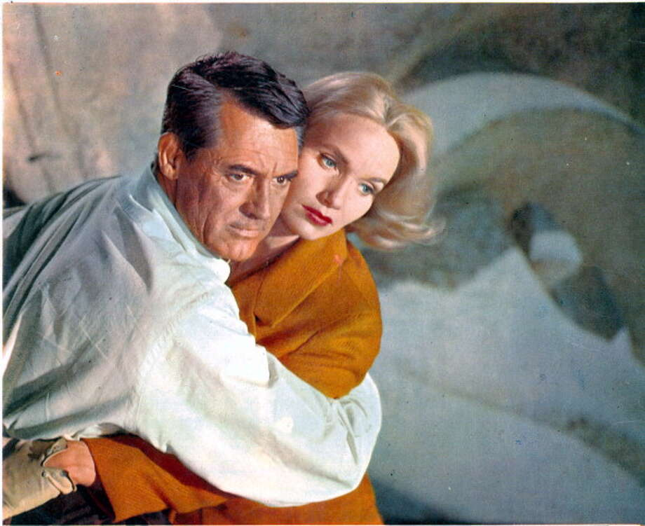 Cary Grant holding Eva Marie Saint in a scene from the film 'North By Northwest', 1959. (Photo by Metro-Goldwyn-Mayer/Getty Images) Photo: Archive Photos, Getty Images / 2012 Getty Images