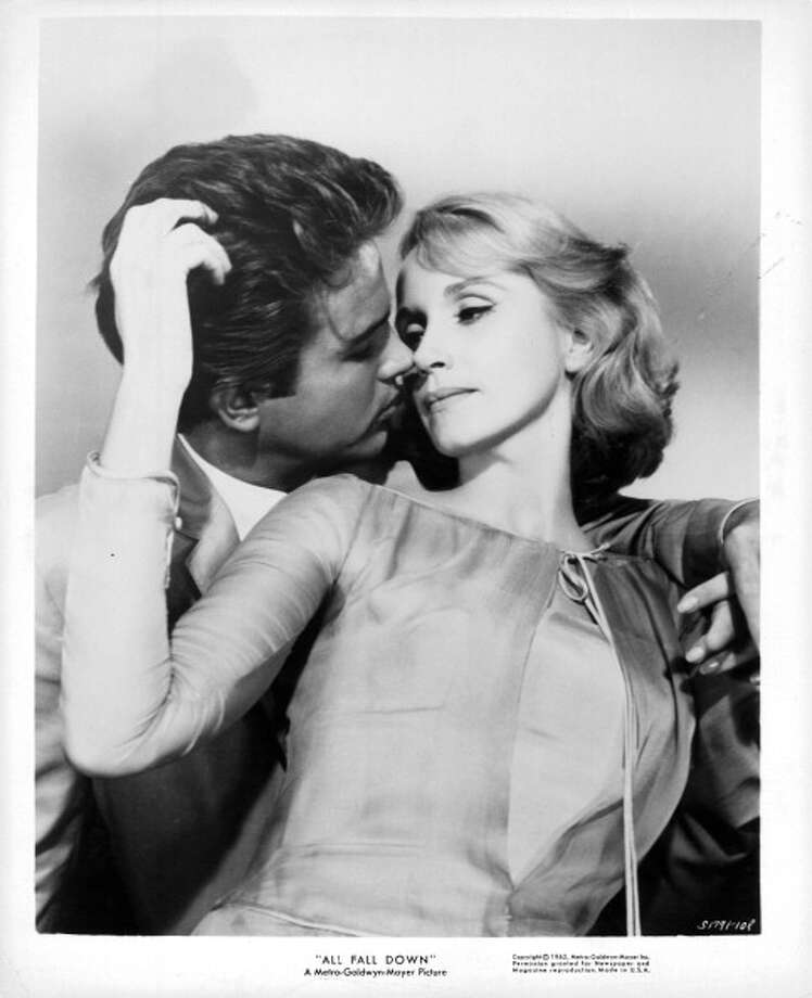 Warren Beatty moving in to kiss Eva Marie Saint in publicity portrait for the film 'All Fall Down', 1962. (Photo by Metro-Goldwyn-Mayer/Getty Images) Photo: Archive Photos, Getty Images / 2012 Getty Images