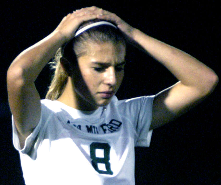The Green Wave's Saige Grazia is in disbelief seconds after New Milford High School girls' soccer had lost a 2-1 double-overtime decision to Pomperaug in the South-West Conference final at Newtown High. Nov. 1, 2013 afte Photo: Norm Cummings / The News-Times