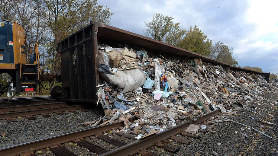 This photo shows two rail cars filled with trash at the scene of a train derailment in Millcreek Township, near Erie, Pa., Friday, Nov. 1, 2013. No one was injured in the incident. (AP Photo/Erie Times-News, Christopher Millette) Photo: Christopher Millette, AP / Erie Times-News